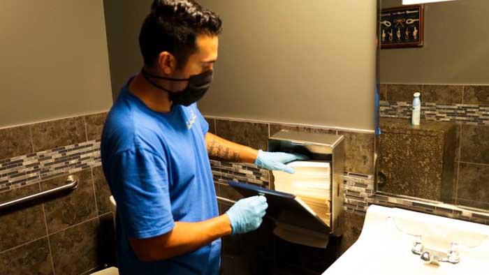 Santa Clarita Excellence Cleaning Professionals Man Replacing Paper Towels