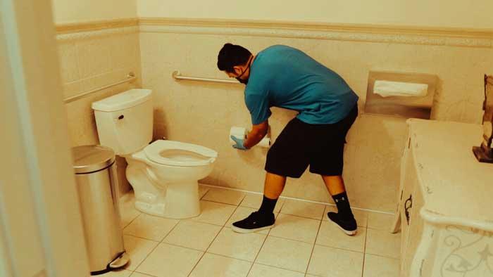 Santa Clarita Excellence Cleaning Professionals Man Replacing Toilet paper