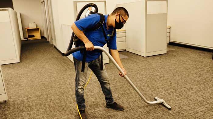 Santa Clarita Excellence Cleaning Professionals Vacuuming Floor
