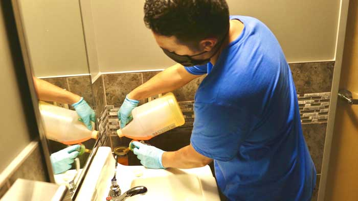 Man from excellence cleaning pros adding soap